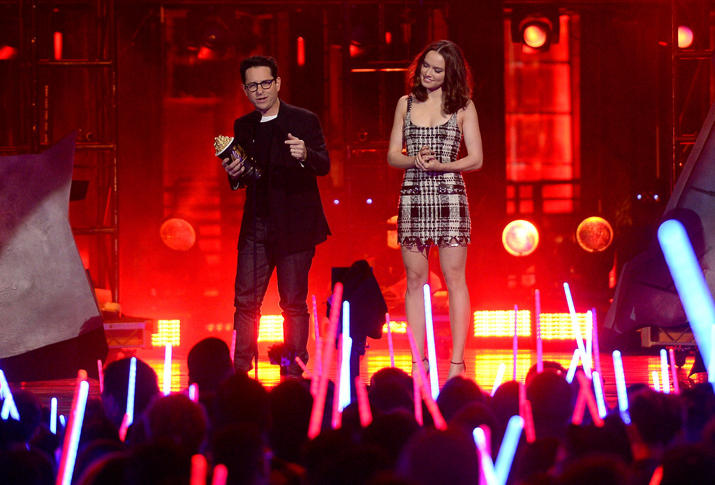 . J.J. Abrams, left, and Daisy Ridley accept the award for movie of the year for �Star Wars: The Force Awakens� at the MTV Movie Awards at Warner Bros. Studio on Saturday, April 9, 2016, in Burbank, Calif. (Kevork Djansezian/Pool Photo via AP)
