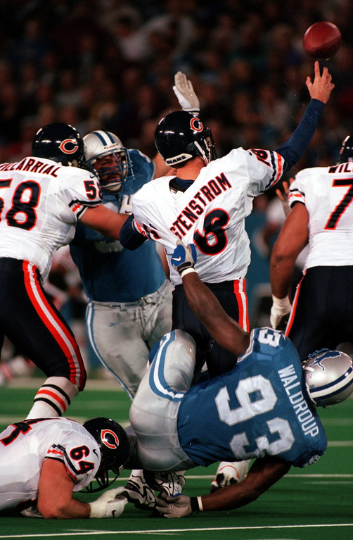 . Kerwin Waldroup (93) of the Detroit Lions pulls down Bears quarterback Stewve Stenstrom (18) in the first quarter during Sunday night\'s game at the Pontiac Silverdome.