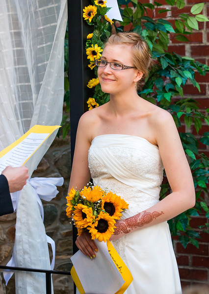 Bride at the altar listening to vows.jpg