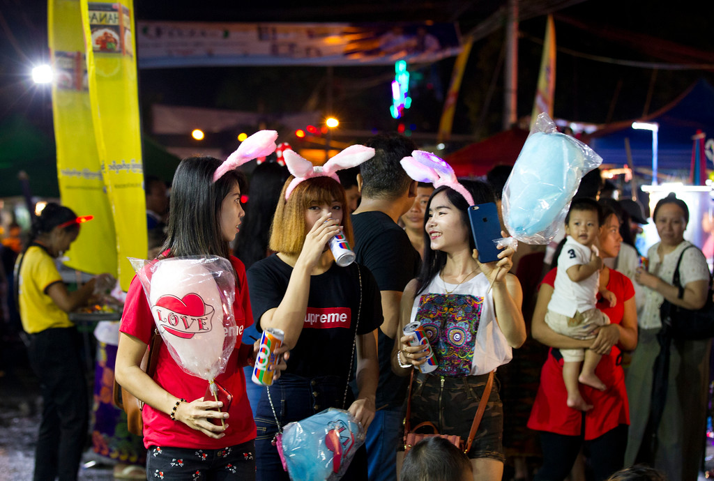 . Festival goers enjoy the annual local night bazaar to mark the Thadingyut festival in downtown Yangon, Myanmar, Wednesday, Oct. 4, 2017. The Thadingyut festival, also known as lighting festival, is held around the country at the end of Buddhist Lent marking Buddha\'s descent from heaven after He sermonized the Abhidamma to His mother who was born in heaven. (AP Photo/Thein Zaw)