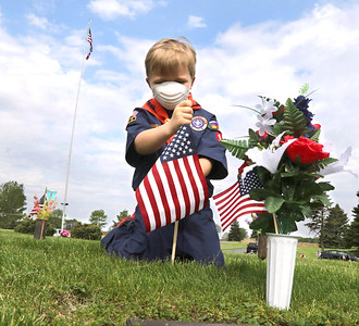 052320 Scouts plant flags at cemetery for Memorial Day