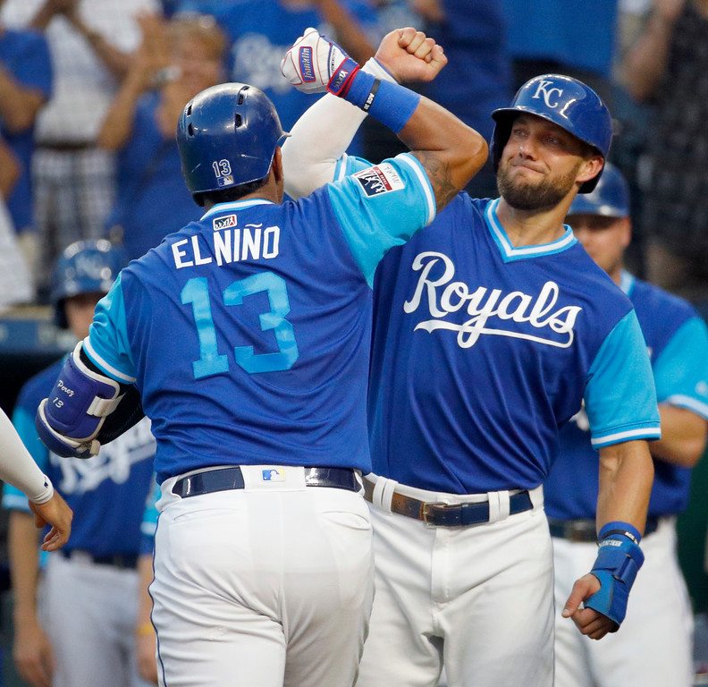 . Kansas City Royals\' Salvador Perez (13) celebrates with Alex Gordon after hitting a three-run home run during the first inning of a baseball game against the Cleveland Indians on Friday, Aug. 24, 2018, in Kansas City, Mo. (AP Photo/Charlie Riedel)