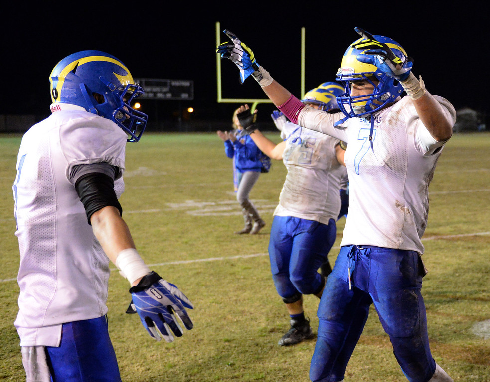 . San Dimas players celebrate their win over Arroyo after their CIF Semi-Final football game at Arroyo High School in El Monte on Friday November 29, 2013. (San gabriel Valley Tribune/Staff Photo by Keith Durflinger)