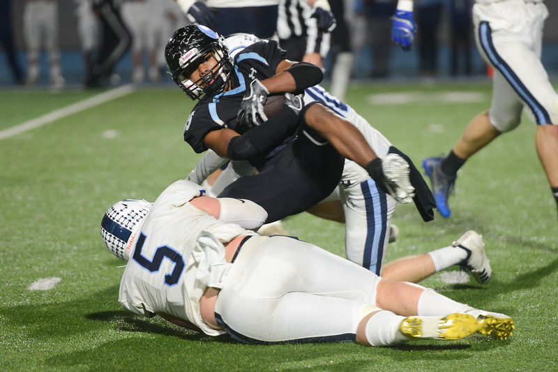 Pleasant Valley's Anthony Ioane glides through Central Valley Christian's Spencer Morris and Tyce Griswold in the CIF State Championship game, Dec. 8, 2018, in Chico. (Carin Dorghalli -- Enterprise-Record)