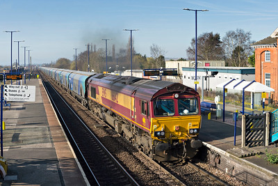 DB Class 66142 powers through Barnetby with Drax to Immingham empty biomass train