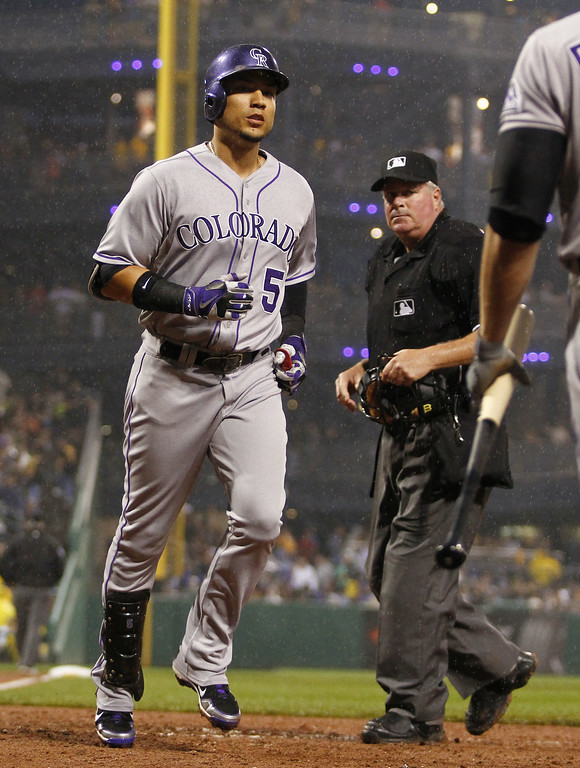 . PITTSBURGH, PA - JULY 19: Carlos Gonzalez #5 of the Colorado Rockies crosses home after hitting a two run home run in the seventh inning against the Pittsburgh Pirates during the game at PNC Park July 19, 2014 in Pittsburgh, Pennsylvania. (Photo by Justin K. Aller/Getty Images)
