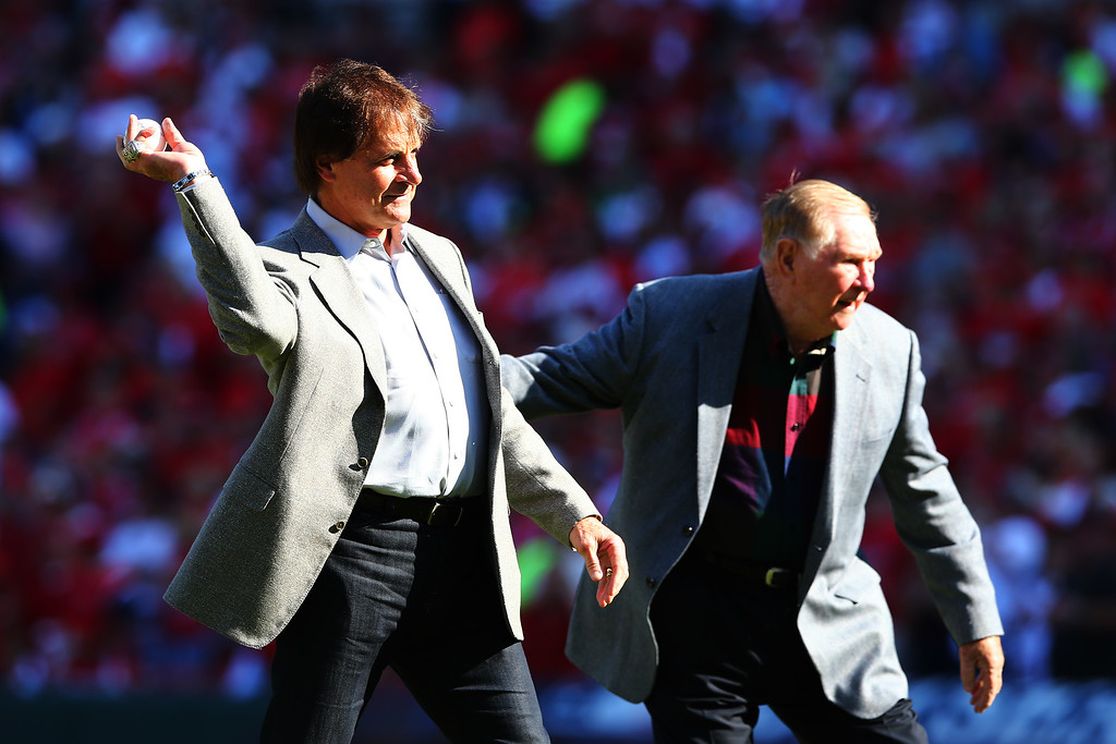 . ST LOUIS, MO - OCTOBER 12:  Tony La Russa and Red Schoendienst throw out the ceremonial first pitch prior to Game Two of the National League Championship Series between the St. Louis Cardinals and the Los Angeles Dodgers at Busch Stadium on October 12, 2013 in St Louis, Missouri.  (Photo by Elsa/Getty Images)