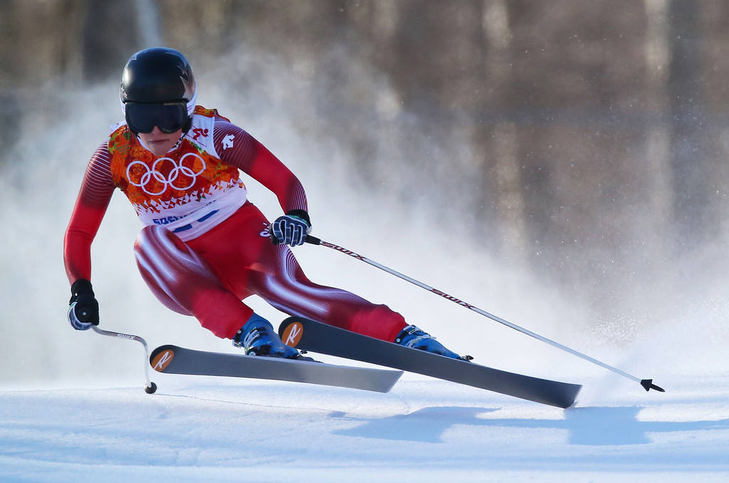 . SOCHI, RUSSIA - FEBRUARY 12:  Lara Gut of Switzerland skis during the Alpine Skiing Women\'s Downhill on day 5 of the Sochi 2014 Winter Olympics at Rosa Khutor Alpine Center on February 12, 2014 in Sochi, Russia.  (Photo by Clive Rose/Getty Images)
