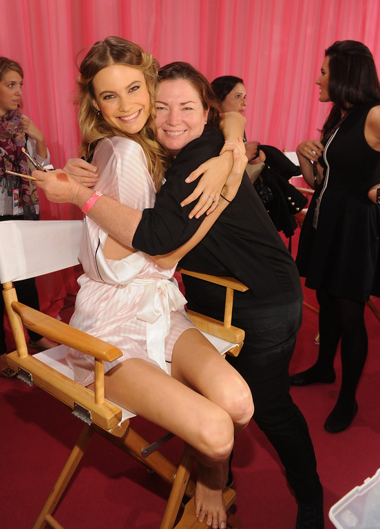 . Victoria\'s Secret model Behati Prinsloo and makeup artist Coleen Creighton pose at the 2013 Victoria\'s Secret Fashion Show hair and makeup room at Lexington Avenue Armory on November 13, 2013 in New York City.  (Photo by Jamie McCarthy/Getty Images)