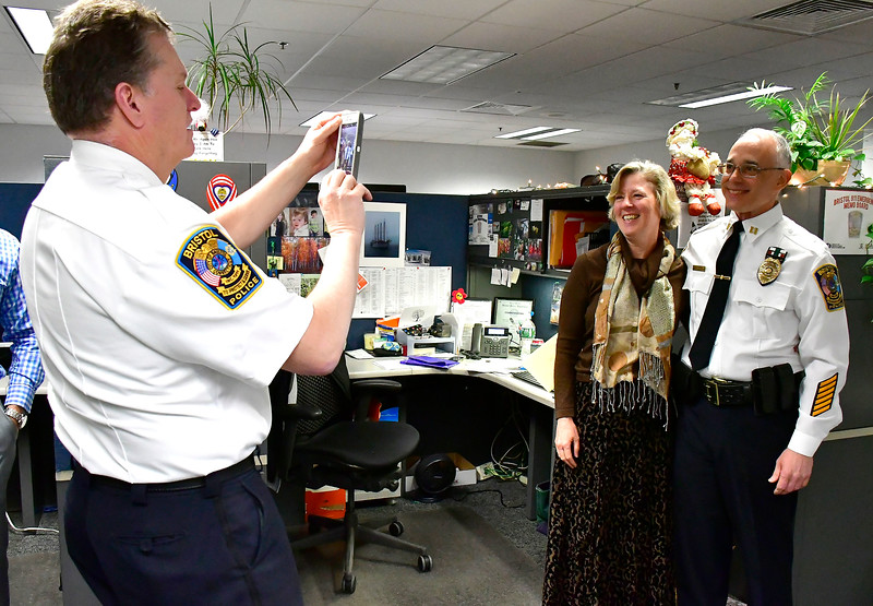 2/28/2019 Mike Orazzi | Staff Bristol Police Captain Edward Spyros gets a photo duringretirement of Bristol Police Captain Thomas Calvello and his wife Allison  at police headquarters on Thursday.
