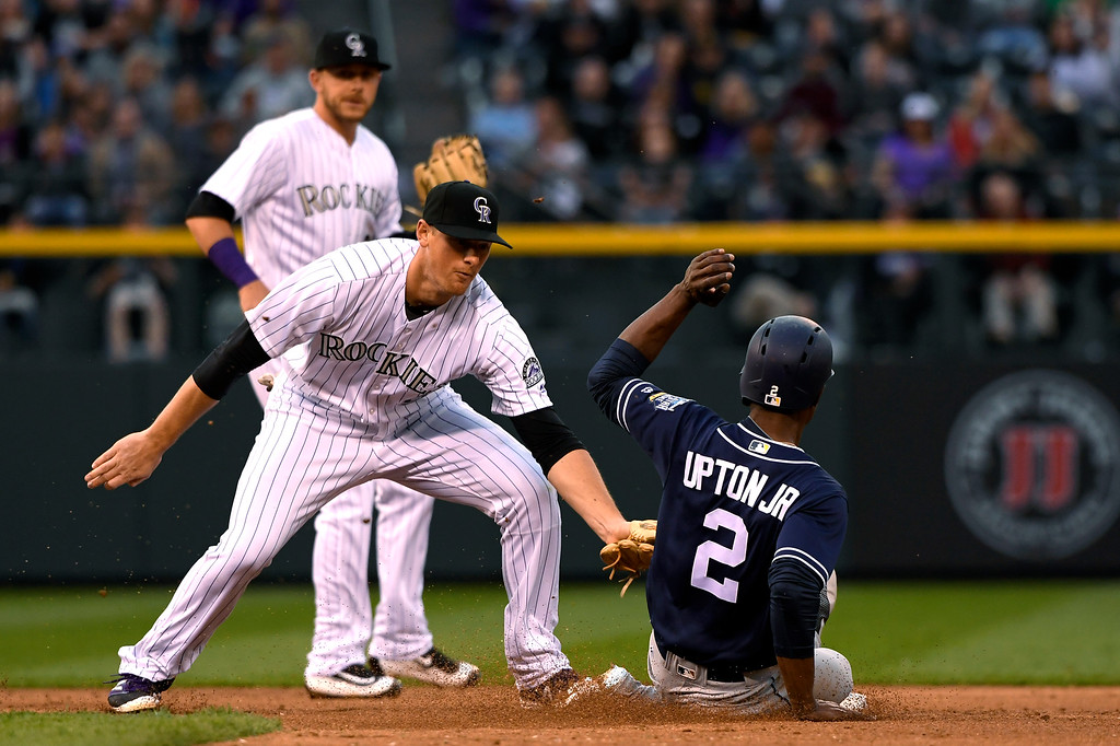 . DJ LeMahieu (9) of the Colorado Rockies makes the tag on Melvin Upton Jr. (2) of the San Diego Padres he was called safe but it was overturned at Coors Field. April 09, 2016 in Denver, CO. (Photo By Joe Amon/The Denver Post)