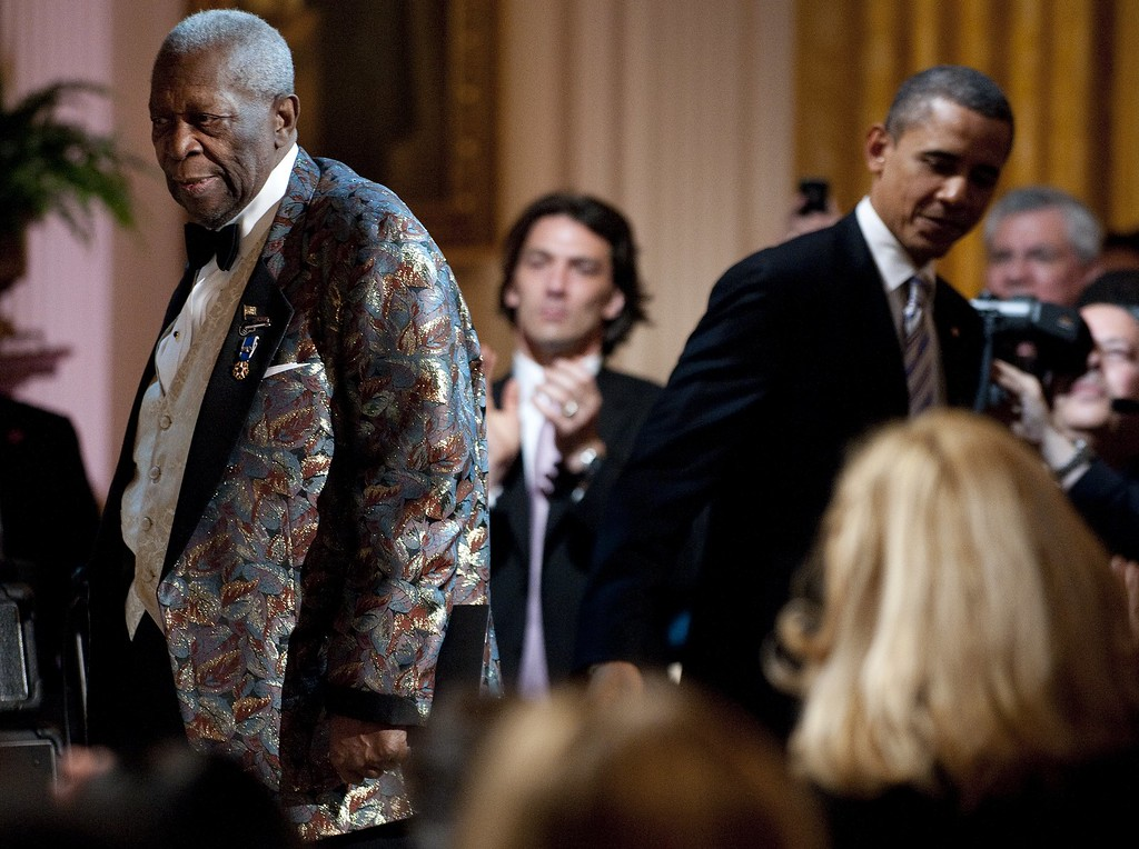 . US President Barak Obama (R) departs after helping Blues musician B.B. King (L) to the stage during a celebration of Blues music and in recognition of Black History Month as part of their �In Performance at the White House� series in Washington, DC,  February 21, 2012.            (JIM WATSON/AFP/Getty Images)