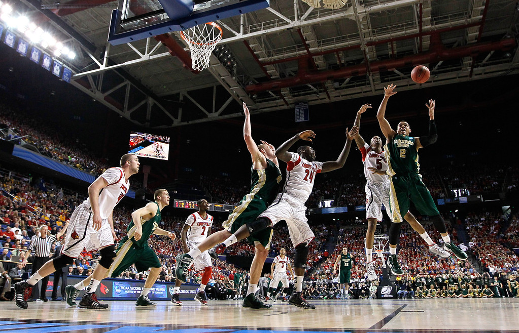 . LEXINGTON, KY - MARCH 23: Daniel Bejarano #2 of the Colorado State Rams and Kevin Ware #5 of the Louisville Cardinals go up for a rebound in the first half during the third round of the 2013 NCAA Men\'s Basketball Tournament at Rupp Arena on March 23, 2013 in Lexington, Kentucky.  (Photo by Kevin C. Cox/Getty Images)