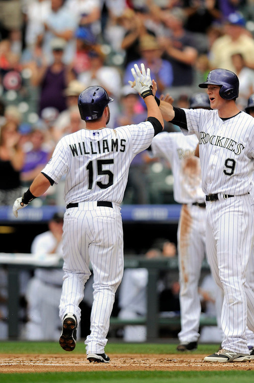 . Colorado Rockies\' Jackson Williams, left, is congratulated by DJ LeMahieu, right, after Jackson hit a three-run home run in the second inning of a baseball game against the San Diego Padres Sunday, Sept. 7, 2014, in Denver. (AP Photo/Chris Schneider)
