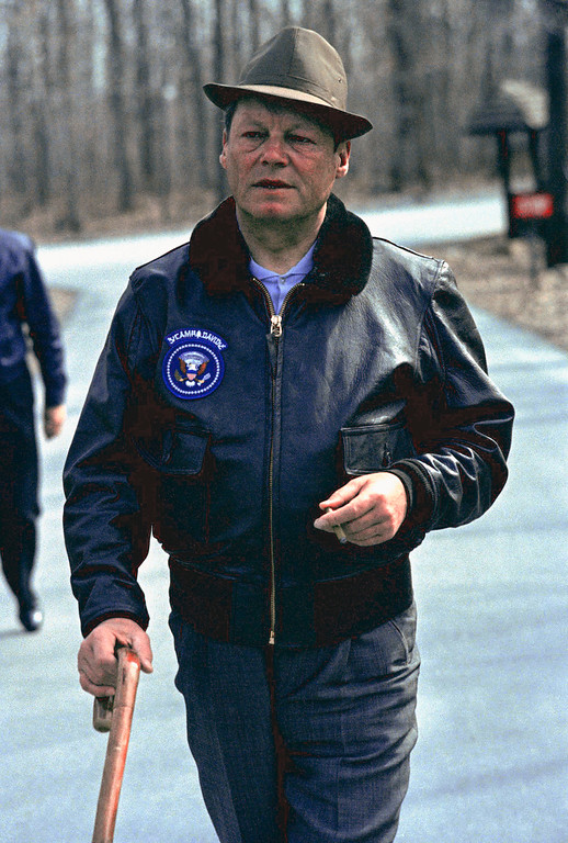 ". 1970: Willy Brandt. Willy Brandt West German Chancellor takes a walking tour of Camp David on April 8, 1970 in Thurmont, Maryland, Presidential retreat of Richard Nixon. Brandt is wearing a leather jacket with the US Presidential Seal and the words ""Camp David.\"" (AP Photo)"