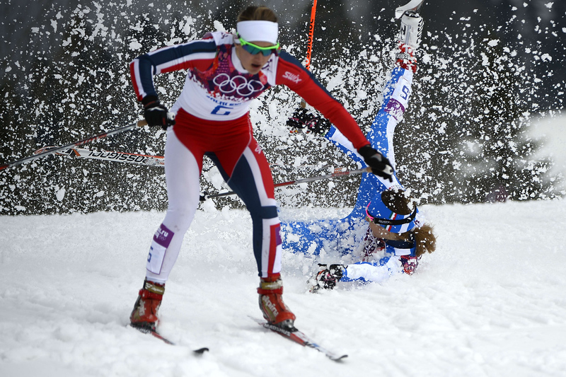 . Italy\'s Greta Laurent falls as Norway\'s Ingvild Flugstad Oestberg skis past as they compete in the Women\'s Cross-Country Skiing Individual Sprint Free Quarterfinals at the Laura Cross-Country Ski and Biathlon Center during the Sochi Winter Olympics on February 11, 2014 in Rosa Khutor near Sochi. (PIERRE-PHILIPPE MARCOU/AFP/Getty Images)