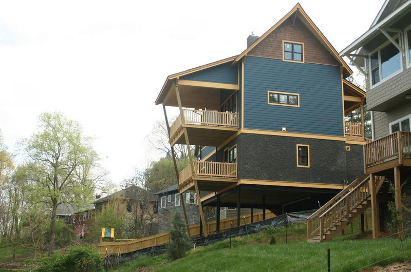 Shape of deck and supports makes this house on a hill look even more precarious - Asheville, North Carolina