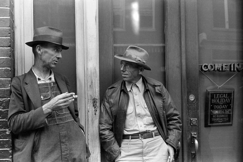 . Two farmers talking outside of a main street bank, Roxboro, North Carolina, Memorial Day, 1940. Jack Delano, Photographer.  Courtesy the Library of Congress