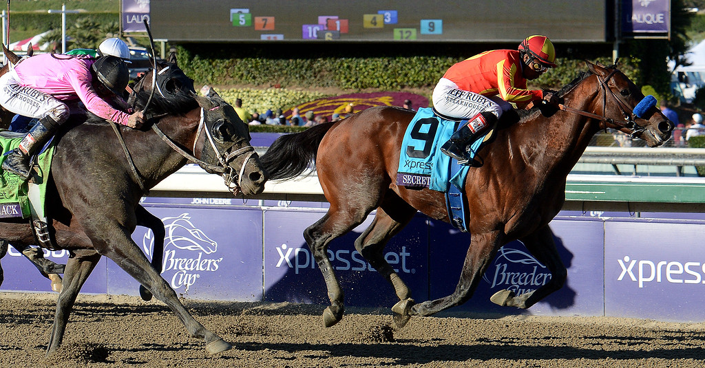". Jockey Martin Garcia atop ""Secret Circle\"" (9) wins the Xpressbet Breeders\' Cup Sprint in the tenth race ahead of jockey Mike Smith atop \""Laugh Track\"" during the Breeders\' Cup at Santa Anita Park in Arcadia, Calif., on Saturday, Nov. 2, 2013.    (Keith Birmingham Pasadena Star-News)"
