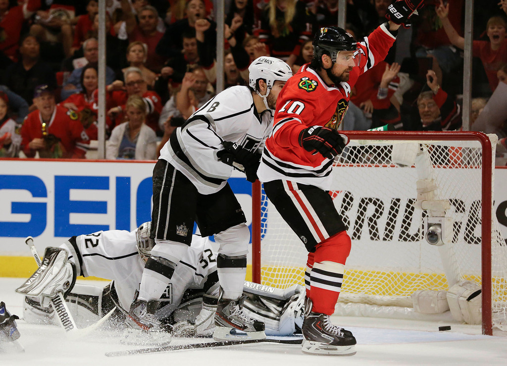 . Chicago Blackhawks center Patrick Sharp (10) reacts after scoring a goal against Los Angeles Kings goalie Jonathan Quick (32) during the second period in Game 1 of the NHL hockey Stanley Cup Western Conference finals Saturday, June 1, 2013 in Chicago.  (AP Photo/Nam Y. Huh)