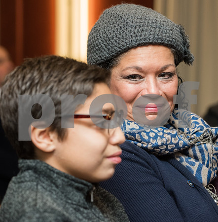 12/19/17 Wesley Bunnell | Staff 12 year old Armani Dante Rivera received recognition before the Police Commissioners meeting on Tuesday evening for his assistance to the New Britain Police Department. Mother Victoria Rivera smiles as the award is read describing her son Armani's actions.