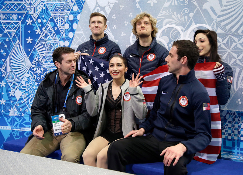 . Marissa Castelli (front C) and Simon Shnapir (front R) of the United States wait for their scores with coach Robert Martin (front L) and teammates (back L-R) Jeremy Abbott, Charlie White and Meryl Davis in the Figure Skating Pairs Short Program during the Sochi 2014 Winter Olympics at Iceberg Skating Palace on February 6, 2014 in Sochi, Russia.  (Photo by Darren Cummings/Pool/Getty Images)