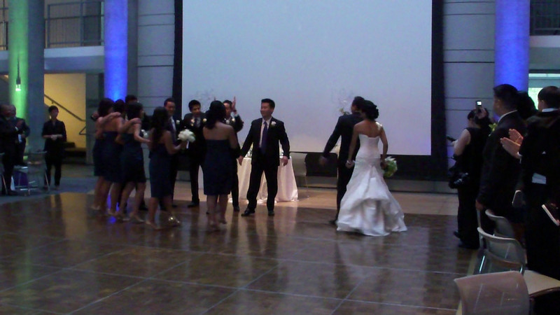 The grand entrance of the bride and groom.  Can you tell that someone is a sports fan?