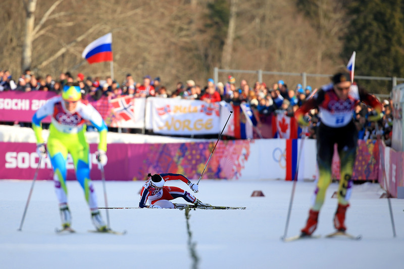 . Marit Bjoergen of Norway (C) collapses in the Finals of the Ladies\' Sprint Free during day four of the Sochi 2014 Winter Olympics at Laura Cross-country Ski & Biathlon Center on February 11, 2014 in Sochi, Russia.  (Photo by Richard Heathcote/Getty Images)