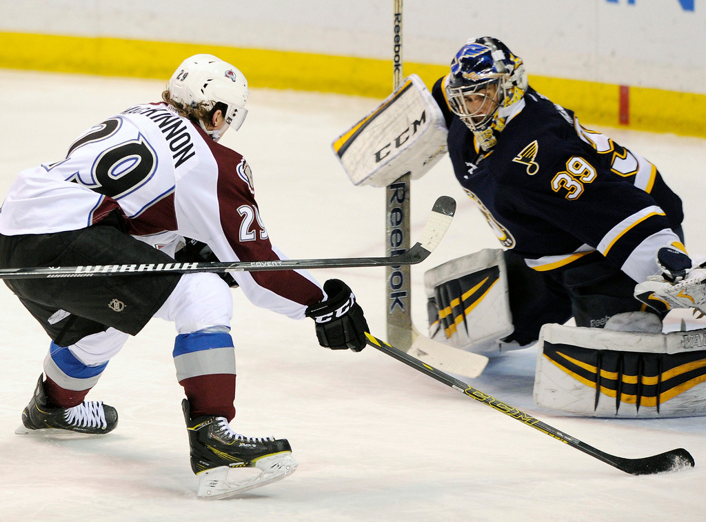 . St. Louis Blues\' goalie Ryan Miller (39) defends against Colorado Avalanche\'s Nathan MacKinnon (29) during the third period of an NHL hockey game, Saturday, April 5, 2014, in St. Louis. (AP Photo/Bill Boyce)