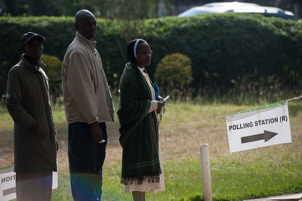 . Voters queue to cast their ballot at St. Matthews church in the Langata constituency of the Kenyan capital, Nairobi, on March 4, 2013 during the elections. Long lines of Kenyans queued from far before dawn to vote Monday in the first election since the violence-racked polls five years ago, with a deadly police ambush hours before polling started marring the key ballot. The tense elections are seen as a crucial test for Kenya, with leaders vowing to avoid a repeat of the bloody 2007-8 post-poll violence in which over 1,100 people were killed, with observers repeatedly warning of the risk of renewed conflict.     PHIL MOORE/AFP/Getty Images