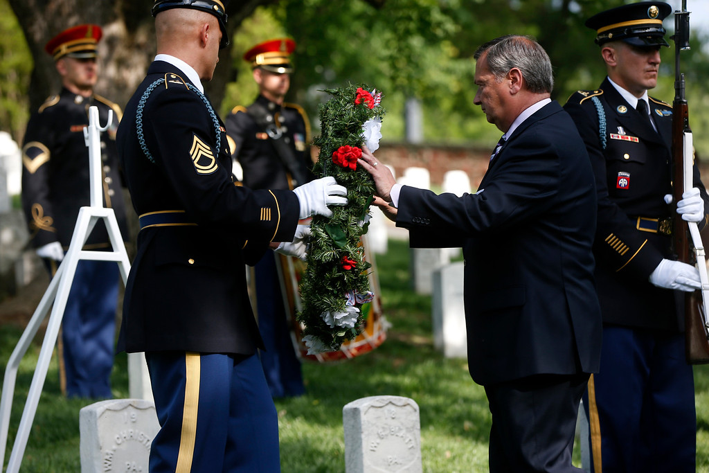 . Jack Lechner, Deputy Superintendent of Arlington National Cemetery, lays a wreath at the gravesite of Army Pvt. William Christman, who was the first military burial at the cemetery, marking the beginning of commemorations of the 150th anniversary of Arlington National Cemetery in Arlington, Va., Tuesday, May 13, 2014.  (AP Photo)