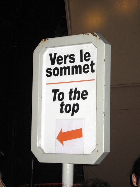 Sign directing visitors to the top of the Eiffel Tower in Paris