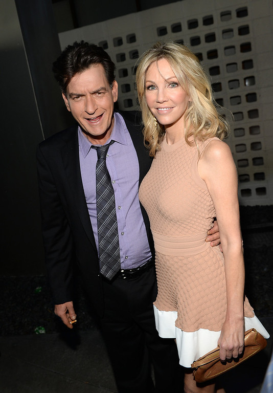 ". Actors Charlie Sheen and Heather Locklear arrive for the premiere of Dimension Films\' ""Scary Movie 5\"" at ArcLight Cinemas Cinerama Dome on April 11, 2013 in Hollywood, California.  (Photo by Michael Buckner/Getty Images)"