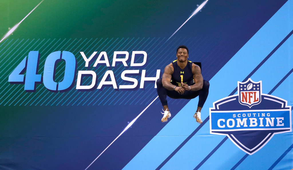 . Oklahoma State running back Christopher Carson prepares to run the 40-yard dash at the NFL football scouting combine Friday, March 3, 2017, in Indianapolis. (AP Photo/David J. Phillip)