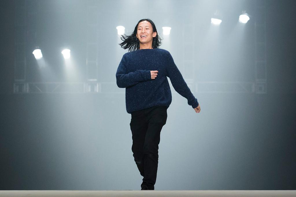 . Designer Alexander Wang greets the audience following his Fall 2013 fashion show during Fashion Week, Saturday, Feb. 9, 2013, in New York. (AP Photo/John Minchillo)
