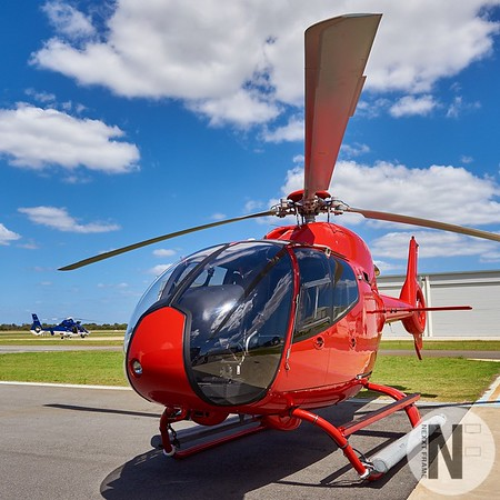 Sporty Red EC120 at Rotorvation Helicopters Jandakot