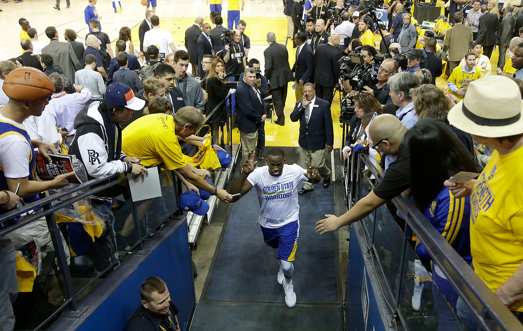 . Golden State Warriors forward Draymond Green exits the court before Game 1 of basketball\'s NBA Finals against the Cleveland Cavaliers in Oakland, Calif., Thursday, June 4, 2015. (AP Photo/Jeff Chiu)
