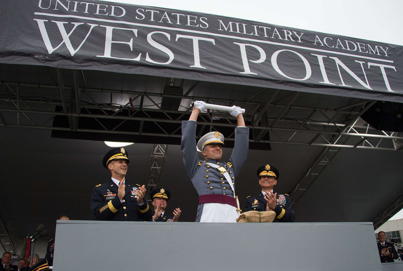 ". The ""goat\"" Matthew Mayeaux, the lowest ranked in the graduating class, holds up his diploma, during commencement exercises at the United States Military Academy at West Point, New York, May 28, 2014. (JIM WATSON/AFP/Getty Images)"