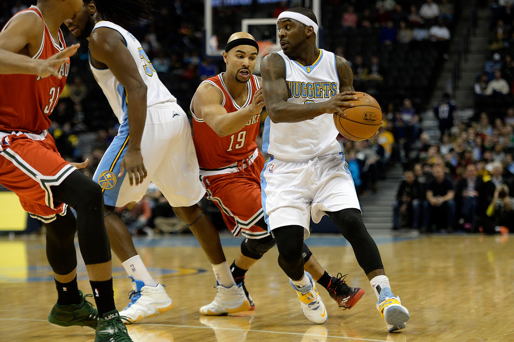. DENVER, CO - MARCH 03: Ty Lawson (3) of the Denver Nuggets drives against the defense of Jerryd Bayless (19) of the Milwaukee Bucks during the first quarter of action. The Denver Nuggets hosted the Milwaukee Bucks at the Pepsi Center on Tuesday, March 3, 2015. (Photo by AAron Ontiveroz/The Denver Post)
