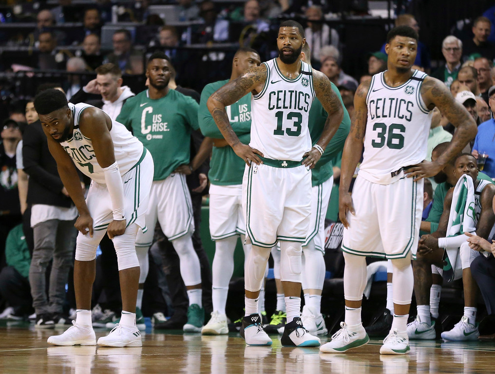 . Boston Celtics players stand near the bench near the end of the second half in Game 7 of the NBA basketball Eastern Conference finals against the Cleveland Cavaliers, Sunday, May 27, 2018, in Boston. (AP Photo/Elise Amendola)