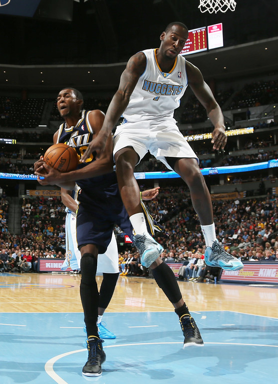 . Denver Nuggets forward J.J. Hickson, right, fouls Utah Jazz forward Jeremy Evans as he drives the lane for a shot in the fourth quarter of Utah\'s 103-93 victory in an NBA basketball game in Denver on Friday, Dec. 13, 2013. (AP Photo/David Zalubowski)