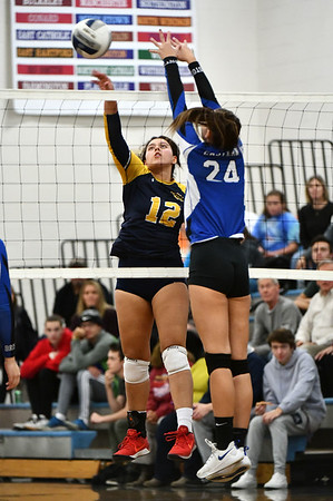 11/16/2019 Mike Orazzi | StaffrWoodstock Academy's Paula Hernandez Aulet (12) and Bristol Easterns Sage Scarritt (24) during the 2019 State Girls Volleyball Tournament Class L Quarterfinals at BEHS in Bristol Saturday.