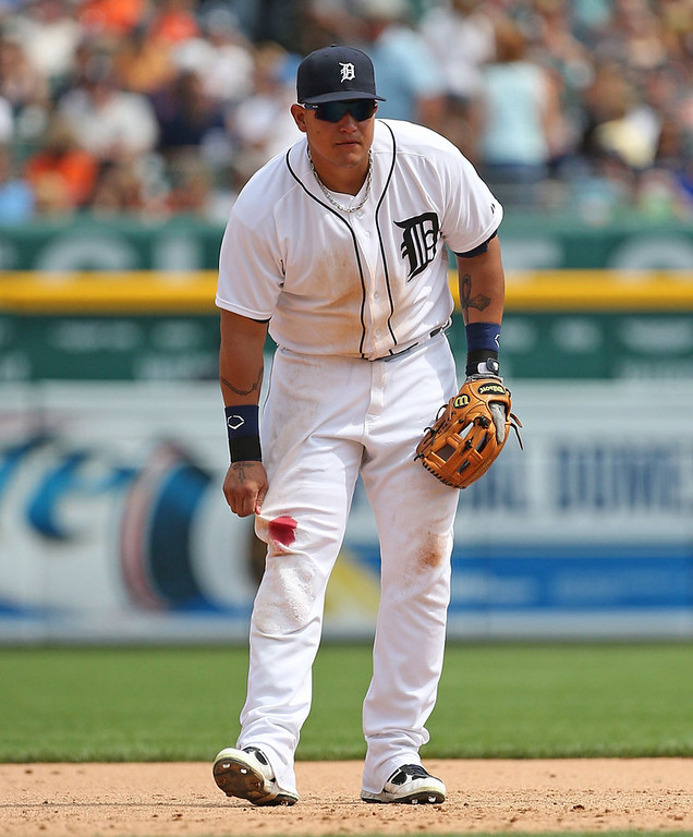 . Tigers third baseman Miguel Cabrera shows off his blood stain after skinning his right knee while diving for a foul ball in the sixth inning against the Twins.  (Photo by Leon Halip/Getty Images)