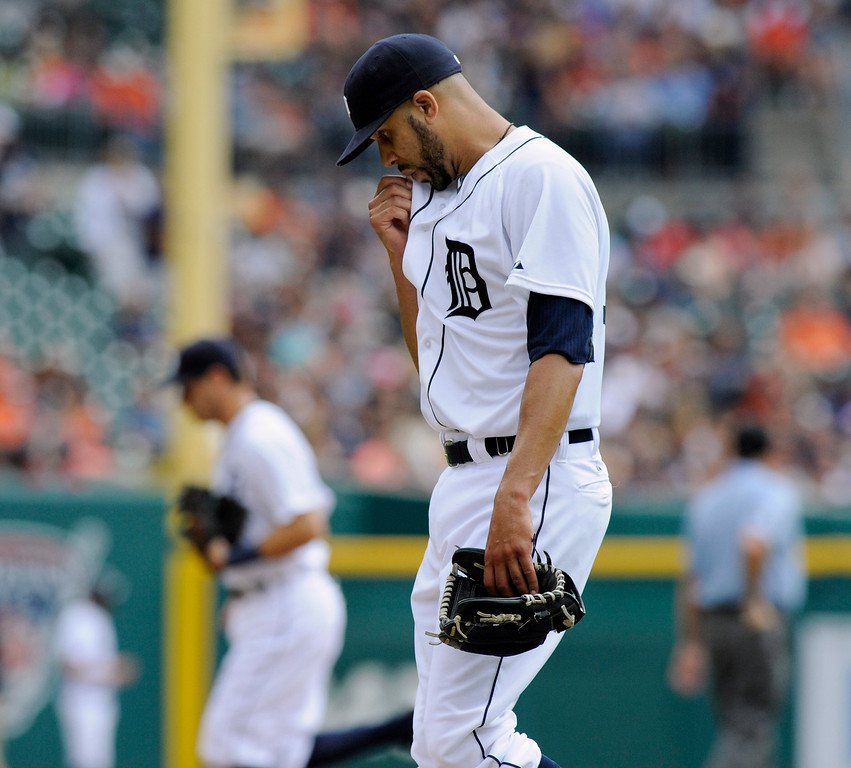 . Detroit Tigers pitcher David Price heads to the dugout after giving up four runs to the San Francisco Giants in the first inning of a baseball game Saturday, Sept. 6, 2014, in Detroit, Mich.  AP Photo/Jose Juarez)