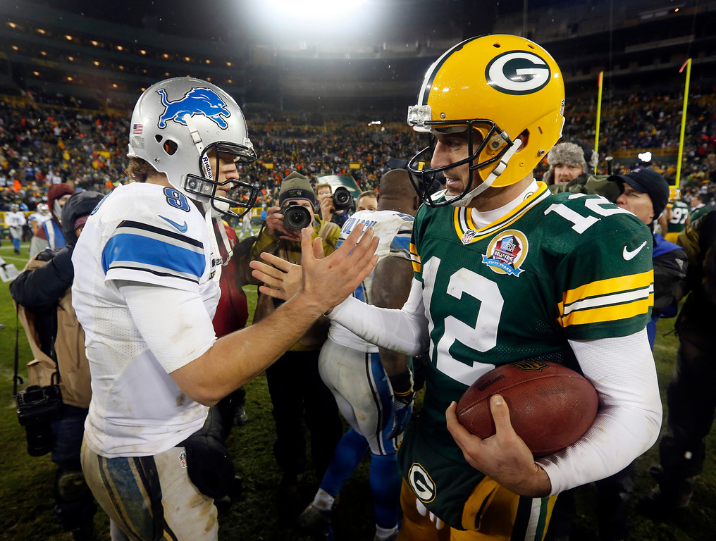 . Green Bay Packers quarterback Aaron Rodgers (12) shakes hands with Detroit Lions quarterback Matthew Stafford (9) after an NFL football game Sunday, Dec. 9, 2012, in Green Bay, Wis. The Packers won 27-20. (AP Photo/Mike Roemer)