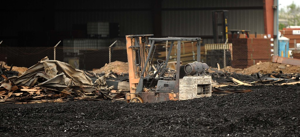 . The Aftermath of a five alarm fire Sunday May 5, 2012  at Ramirez pallet yard at 8400 block of Sultana Avenue in Fontana. The A five-alarm fire engulfed a pallet yard and jumped to an adjoining business on Saturday injuring one firefighter and causing millions of dollars in damages, authorities said.LaFonzo Carter/ Staff Photographer