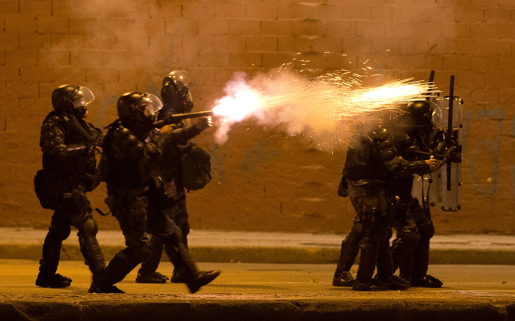 . Military police fire tear gas at protestors during an anti-government demonstration in Rio de Janeiro, Brazil, Thursday, June 20, 2013.  (AP Photo/Victor R. Caivano)