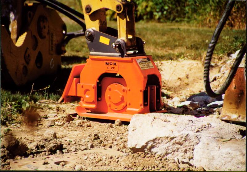 NPK C2C compactor with backfill blade on Cat mini excavator (2).JPG