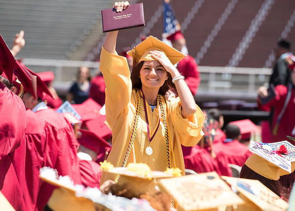 06/19/18 Wesley Bunnell | Staff A New Britain High School senior holds up her diploma and as she faces the crowd during graduation exercises at Veterans' Memorial Stadium at Willow Brook Park on Tuesday morning.