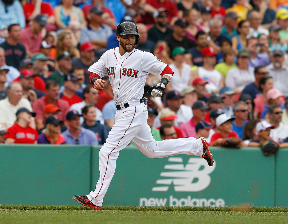 . Dustin Pedroia #15 of the Boston Red Sox scores a run against the Colorado Rockies in the 3rd inning at Fenway Park on June 26, 2013 in Boston, Massachusetts.  (Photo by Jim Rogash/Getty Images)
